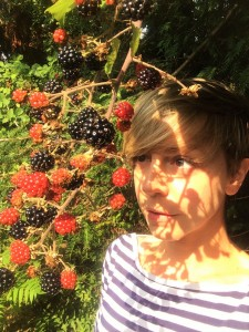 Katy looking at blackberries