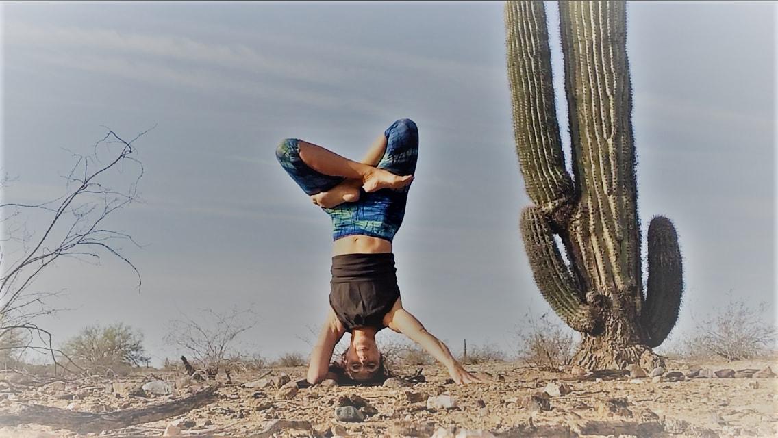Urdvha padmasana next to a cactus